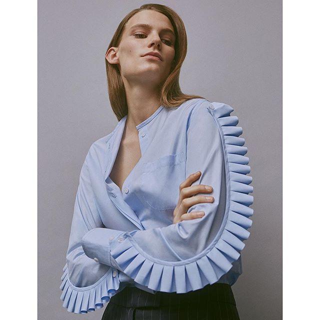 Modern armor. @copernifemme's Fraise shirt with detachable, modular ruffles in crisply crimped cotton poplin. (Photo of @lenaobao by @charlottemwales) #ruffleshaveridges