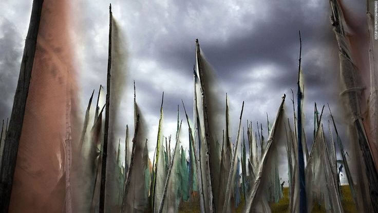 """Canadian Larry Louie traveled to the Tibetan Tagong grasslands of Sichuan province to capture prayer flags fluttering under leaden skies. His image was selected as winner in the """"colors of the world"""" category. (Photo: Larry Louie/www.tpoty.com)"""