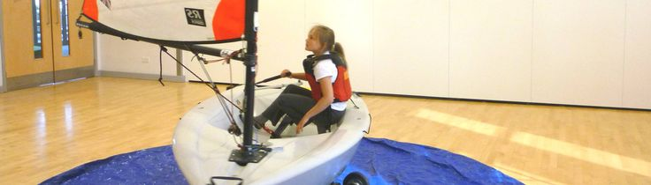 The Simulator: - Dynamic gyrating fully rigged RS Tera Sport Dinghy - Active motorised electronic proportional Rudder Steering - Passive balance system provides realistic boat movements - Raised boom height for safe beginner training - Super quiet Wind source provides a gentle breeze of up to 10 miles per hour - Packs up to easily get through standard Single doorways, if necessary