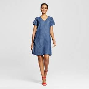Get ready to accessorize with the Women's Denim T-Shirt Dress in Dark Denim by Merona™. This women's denim shift dress refreshes the t-shirt dress and gives it trendy, casual excitement to dress up or down.