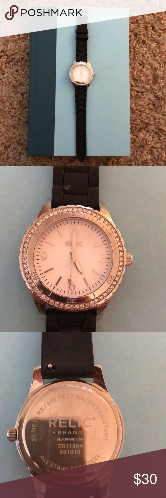 RELIC Watch RELIC Watch White watch face, Silver numbers, gems set in stainless steel around the watch-face Black bands, rubber material Batteries NOT included (they are dead) Relic Accessories Watches