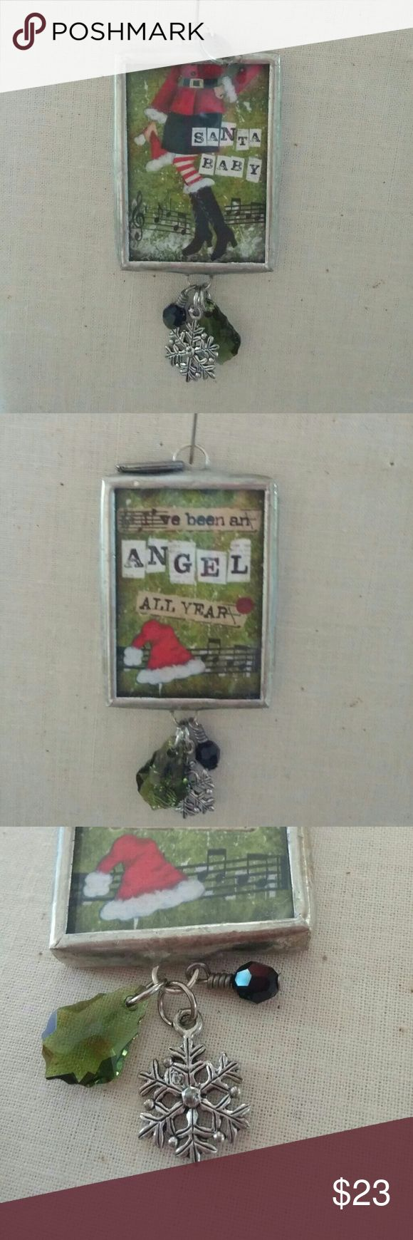 """Jewel Kade Santa Baby Charm This hard to find Santa Baby Charm has a cute saying on one side """"I've been an Angel all Year and a Santa Hat, the other side has music notes with picture of momma Santa in boots, it has cute diver snowflake charm along with a black bead and green Crystal hanging from the bottom.....Super Cute Jewel Kade Jewelry"""