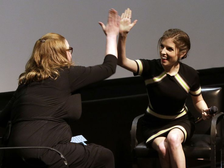 "Comedian Sarah Millican and Anna Kendrick high-five each other during a Q&A after a screening of Kendrick's new movie ""Pitch Perfect 2"" in London May 6.  Joel Ryan, Invision for Universal Pictures via AP"