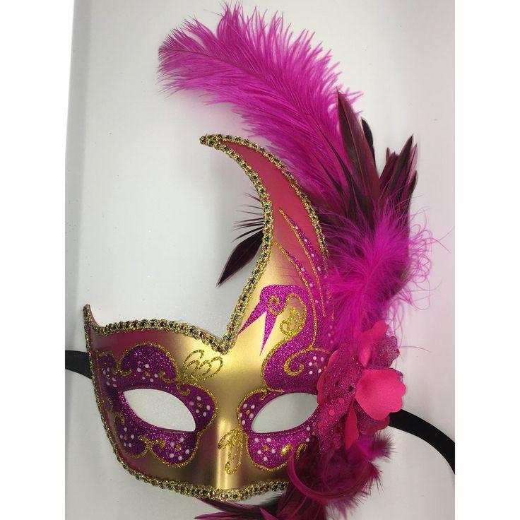 Pink and gold Mardi Gras Masquarade mask with ribbon ties.