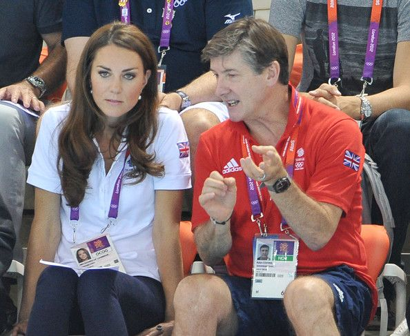 Catherine, Duchess of Cambridge and official team GB ambassador Robin Cousins watch Synchronised Swimming on Day 13 of the London 2012 Olympic Games at the Aquatics Centre on August 9, 2012 in London, England.