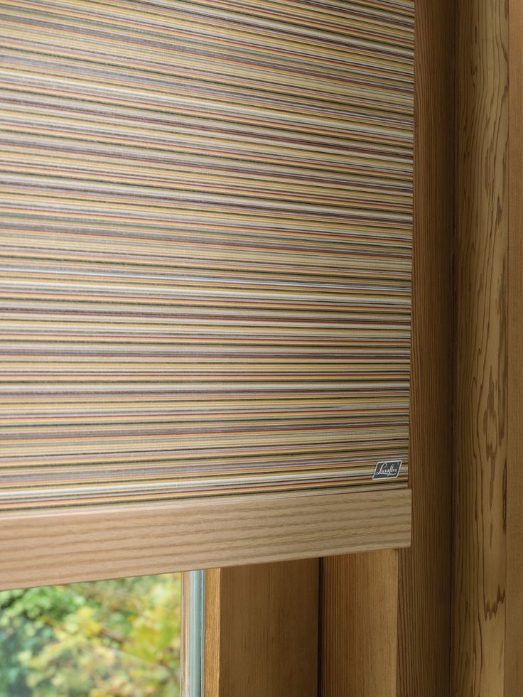 a decorative wood trim at the bottom of the roller blind can provide a stylish effect