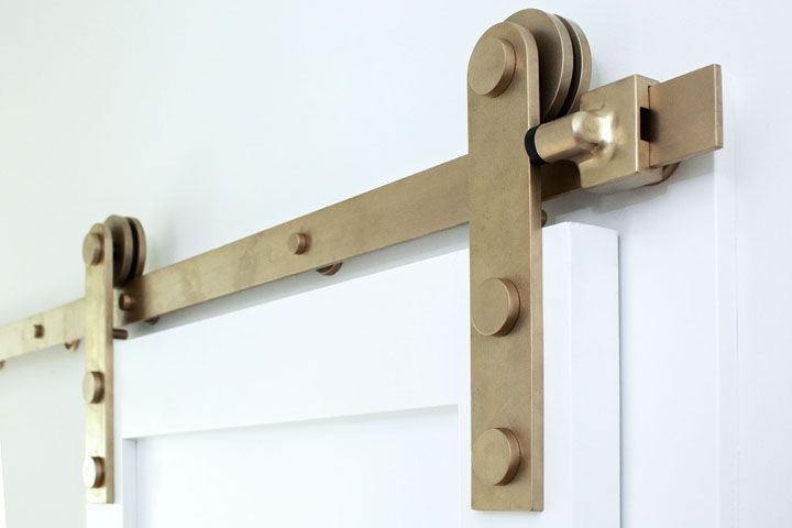 Sun Valley Bronze Barn Door Track In B1 Burnished Brass Finish Photo Kat Cannell Photography Interior Barn Doors Barn Door Track Sun Valley Bronze