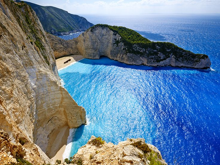 Crystal Blue Water At Shipwreck Beach Attracts Sunbathers And Climbers Alike See The Stunning Greek In Todays Travel 365 Photograph By Bruno