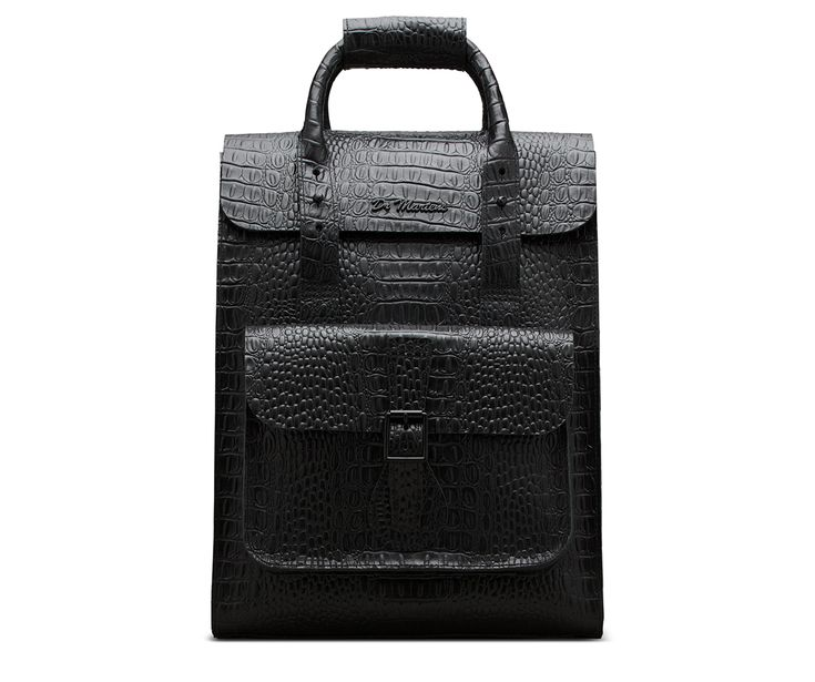 This small backpack is made with classic Doc's durability — because if you're going to carry your life around in a bag, it might as well last. Part of our croc collection, a series of products made with leather embossed with a faux crocodile print, bringing a next-level luxury and classic English feel. Adjustable straps Internal pocket Magnetic popper closure Buckle fastened pocket Made with New Vibrance Croco, a shiny leather embossed with a faux crocodile print Dimensions: 12 wide x...