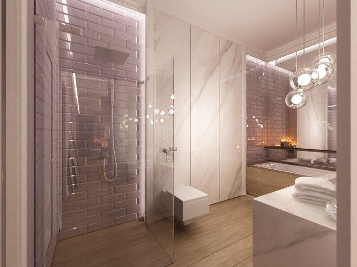 Aranżacja wnętrza luksusowej łazienki w apartamencie w Eko Parku w Warszawie. Wykończona szaro śliwkowymi kafelkami i marmurem. Utrzymana jest w klasycznym stylu.