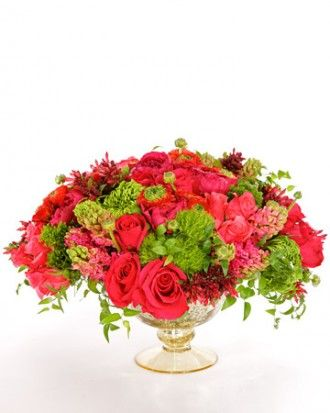 Express your sentiments with a bright and beautiful arrangement featuring carnations, lady slipper orchids, and roses.