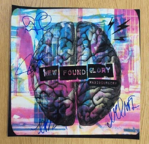 Original AUTOGRAPHED poster for the New Found Glory album Radiosurgery from 2011. Hand-Signed by Jordan Pundik, Chad Gilbert, Steve Klein, Ian Grushka, and Cyrus Bolooki.  12 x 12 inches on photo paper.  Includes a Certificate of Authenticity.
