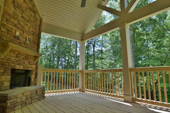 Breckenridge Gameday Porch with HDMI cabling above Stacked Stone Wood Burning Fireplace!   Hughston Homes in Morgan Woods, Auburn, Alabama