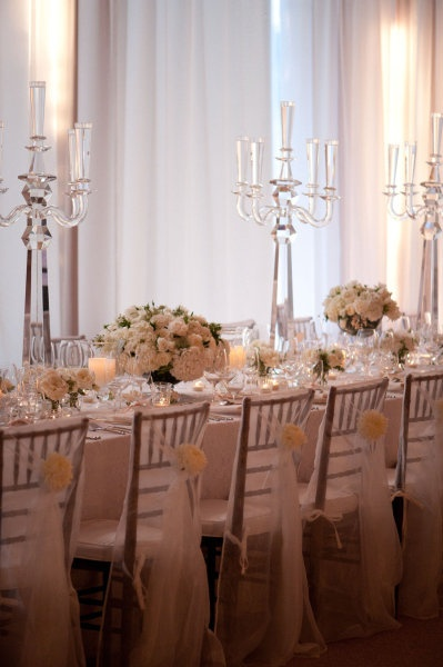 The other long table will have crystal candelabras flanked on either side by mirrored vases filled with white hydrangeas, peachy pink spray roses, and blush roses.  Silver mercury glass votives sprinkled throughout.