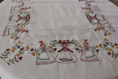 Hand Embroidered table cloth. Design from Ondori Embroidery.