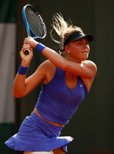 Carina Witthoeft Photos Photos - Carina Witthoeft of Germany hits a backhand during the ladies singles second round match against Pauline Parmentier of France on day five of the 2017 French Open  at Roland Garros on June 1, 2017 in Paris, France. - 2017 French Open - Day Five