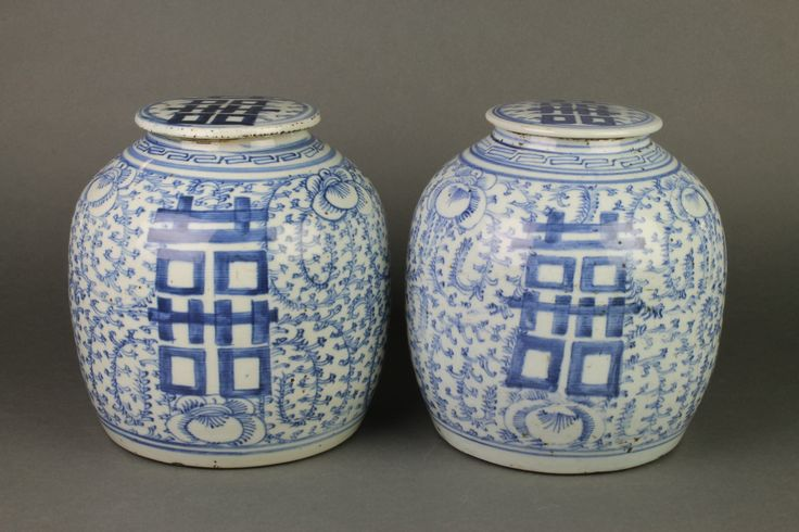 "Lot 130, A pair of 19th Century Chinese Provincial ginger jars and covers decorated with blue and white stylised flowers 10"", est £150-200"