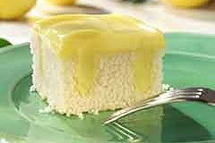 Luscious Lemon Poke Cake-    2   round white cake layers (9 inch), cooled  2  cups  boiling water  1  pkg.  (6 oz.) JELL-O Lemon Flavor Gelatin  1  pkg.  (3.4 oz.) JELL-O Lemon Flavor Instant Pudding  1  cup  cold milk  3  cups  thawed COOL WHIP Whipped Topping