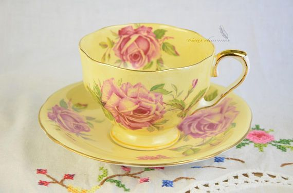 Yellow Aynsley cup and saucer, cabbage roses