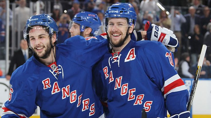 New York Rangers forward Derek Stepan picks the loose puck and fires it past…