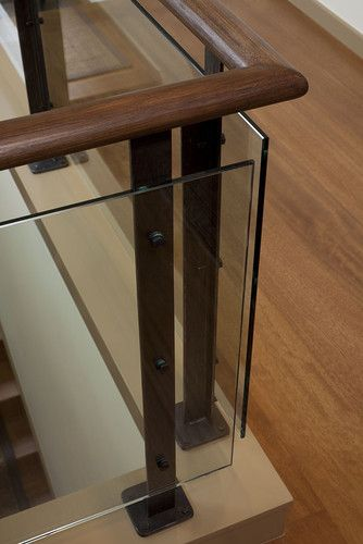 It could also be very cool to just add some glass (for an updated slightly more contemporary feel) on the banister with stand-offs (I can explain what a stand-off is in person)