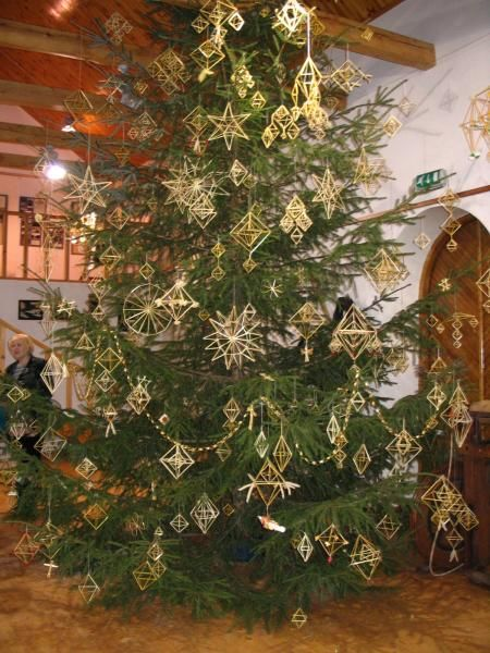 Christmas tree decorated with Latvian tradtional straw ornaments for winter Solstice - Puzurs. Puzurs is similar to Finnish Himmeli and Lithuanian Šiaudinis Sodas.