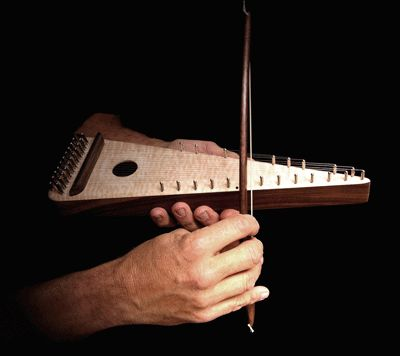 Bowed Psaltery -- saw this man making them today at the Folk Art Center in Asheville. He played a tune on each of the soprano, tenor, and baritone. Hauntingly beautiful!