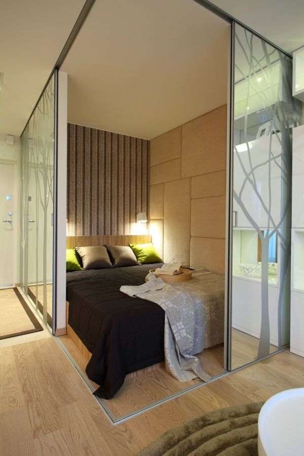 Bedroom/Living Room Partition - Mirrored sliding doors to bedroom. Studio 128 in Poland: Small in Size, Big on Style.