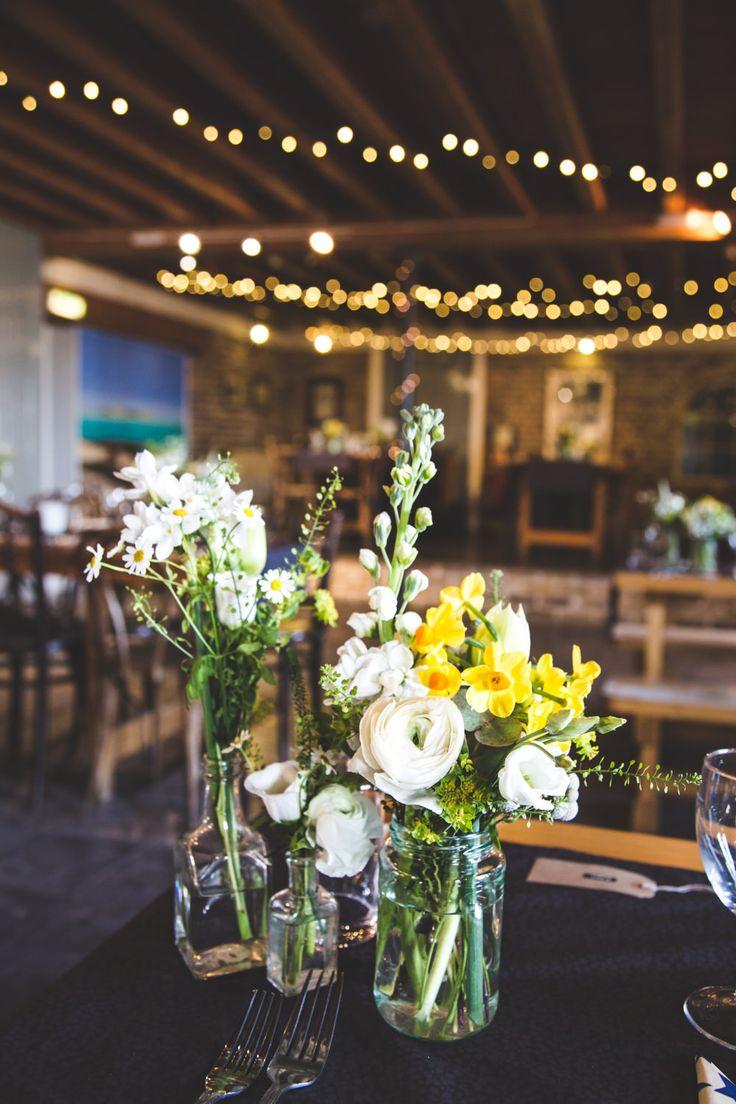 Fairy Lights & Flower Stems in Jars    Charlie Brear Wedding Dress   Coastal Wedding   The East Quay Wedding Venue in Whitstable   The Lobster Shack   Adam Cherry Photography   http://www.rockmywedding.co.uk/chloe-alex/