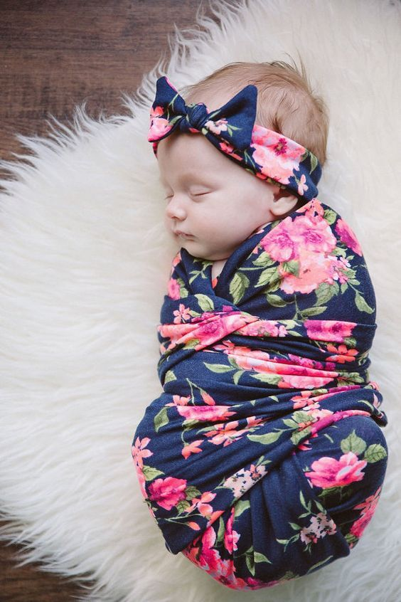 Swaddle and Headband Set This lightweight swaddle is the cutest way to wrap your newborn baby. Its soft and stretchy and perfect to keep your baby comfortable and cool while sleeping. It also is a great blanket to lay your baby on, a great cover while nursing, and a comfort blanket for your toddler to snuggle with as they grow. The swaddle is a perfect baby shower gift as well. Swaddle is made with a rayon/spandex blend and is cut and serged around the edges. It measure approx 40 x 40…