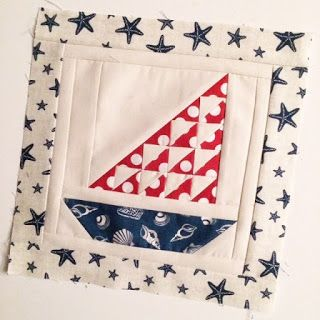 Lily's Quilts - love her choice of graphic modern fabric prints for this sailboat block.