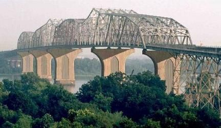 Huey P. Long Bridge over the Mississippi River in Jefferson Parish, Louisiana - It's a narrow bridge that is shared by a train trestle