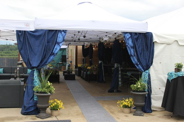 Guests were welcomed through a tented entrance with drape accents, bright pops of yellow flowers and a welcome runner.