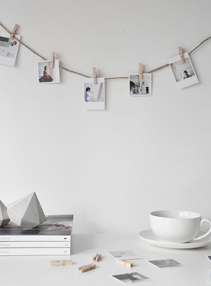 A great DIY for hanging up pictures. All you need is some string and a few wooden pegs.