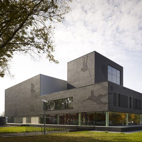 A sports college in eindhoven featuring a black brick for Eindhoven design school