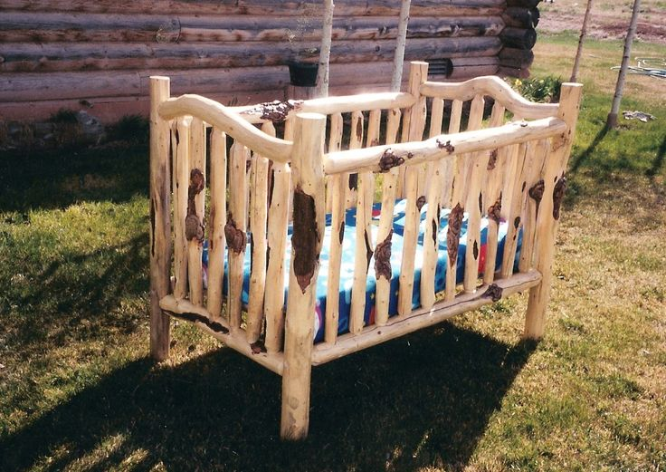 log crib. Hmmmm I think I could make a cute baby room around this ;)