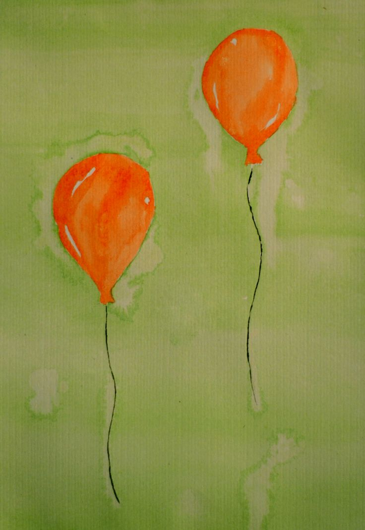 Two orange balloons in the air.