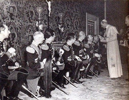 The Pontifical Noble Guard pays homage to Pope Pius XII, Christmas 1945. The Pope's nephew, Prince Giulio Pacelli, is the third guard from the left.