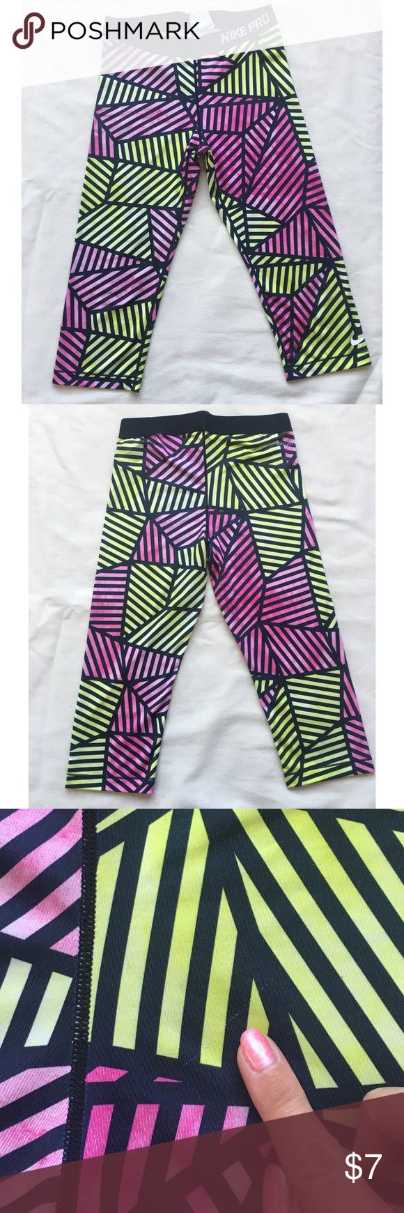 Nike Geometric Workout Tights These workout tights are clutch for crushing a workout! These are used, pilling on the inside of the waistband and a small pull shown on the back. Price reflects used condition. Nike Pants Capris