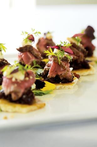 Hors D'oeuvres Splurge: Smoked beef tenderloin on almond-peppercorn flatbread with dried-cherry chutney and micro herbs