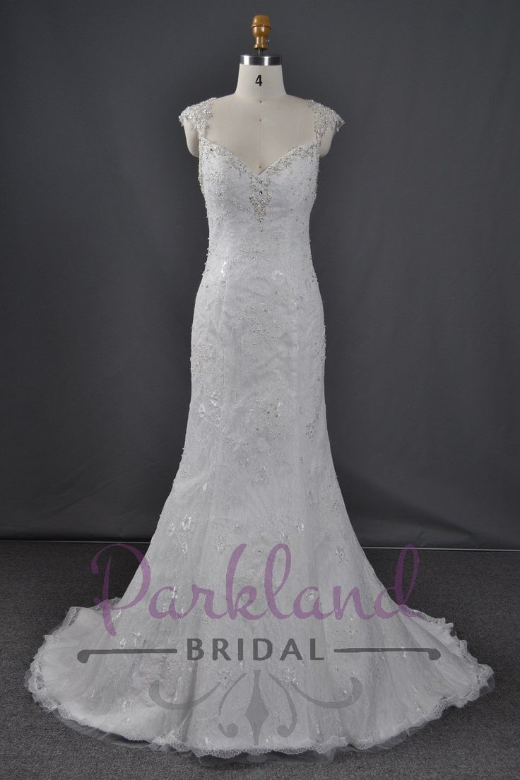A gorgeous full lace mermaid gown. Embellished with luxury beading around the edges of the sweetheart neckline. Scatter beading through the lace. Features a stunning low open back. This gown is absolutely DIVINE! http://www.parklandbridal.co.nz/Store/tabid/4393/ProdID/34778/CatID/358/Parkland_Bridal_Bella.aspx