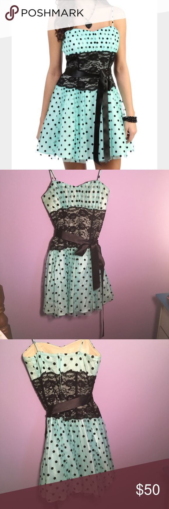 juniors prom/homecoming/formal dress fun flirty 👗 A small women's/juniors A line mint green dress. With polka dots, black lace waist, and satin ribbon around waist. Comfortable and a fun dress to wear. Excellent condition. Dresses Prom
