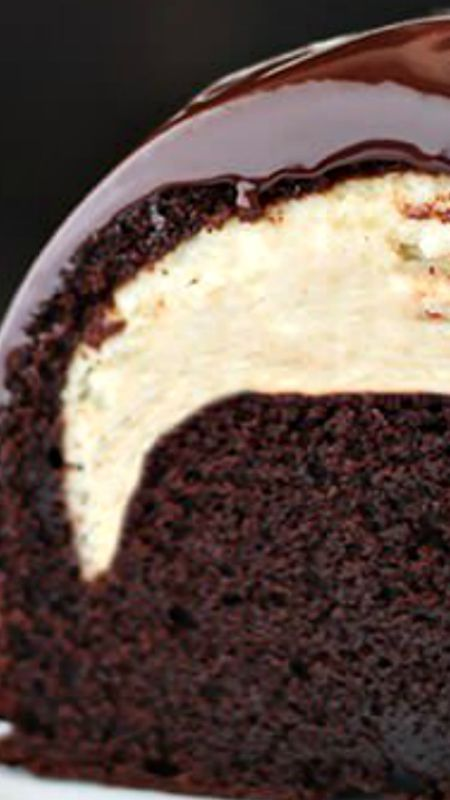 Cheesecake Filled Chocolate Bundt Cake ~ Rich yet tender chocolate cake, surprise cheesecake filling, and thick fudgy glaze