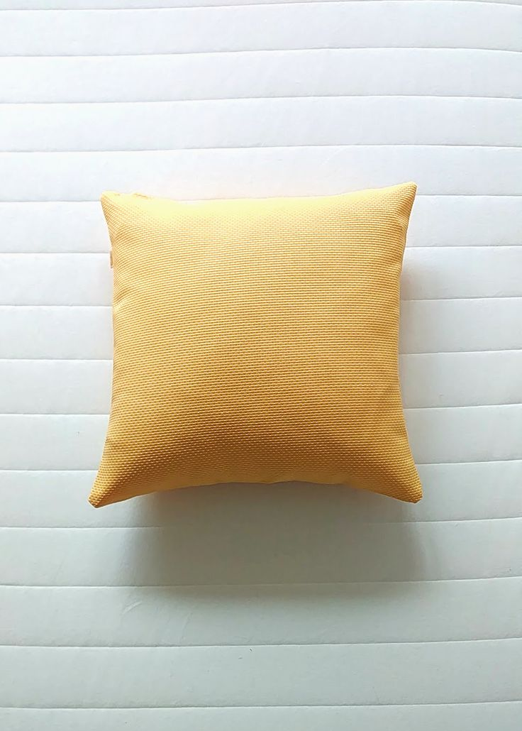 Yellow textured pillow. Scandinavian handmade ethical throw pillow covers. Modern luxury home decor. Limited editions only. Shipping worldwide!