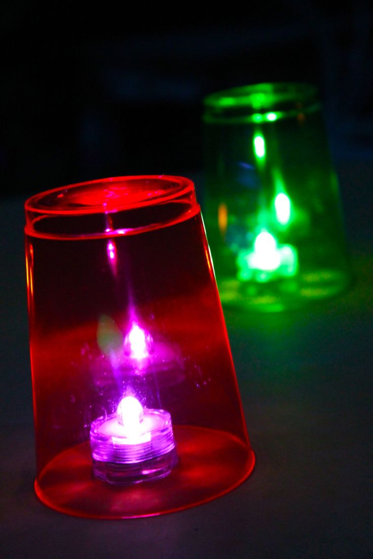 Love this DIY party idea for cheap/effective table lights. We have all colors these submersible LEDs + FYI purple light inparticular makes neon cups GLOW:  http://www.flashingblinkylights.com/light-up-products/light-up-decorations/waterproof-light-ups/led-submersible-craft-lights.html