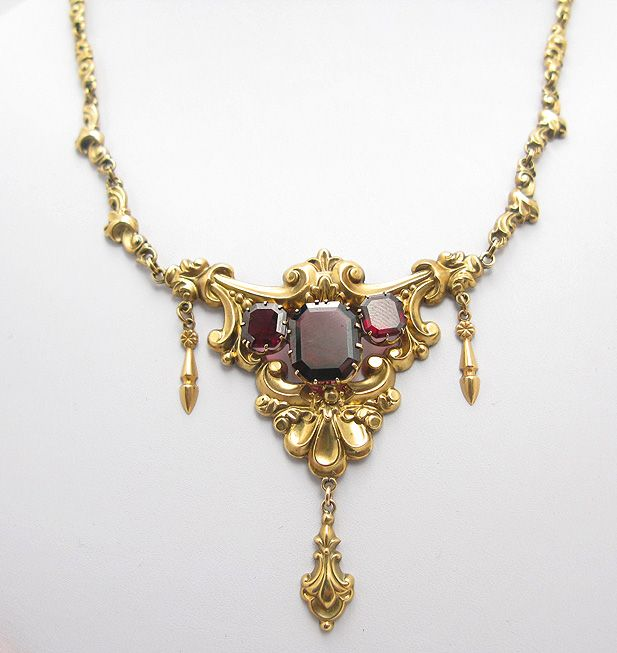 Astounding Victorian Gold Repousse & Garnet Necklace. It dates to c. 1900 and is 14 carat gold repousse with authentic faceted garnet stones.