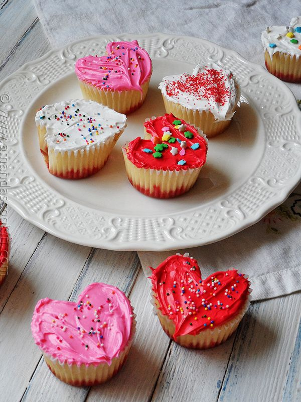 YUM! Easy Heart Shaped Valentine Cupcakes from AmandasCookin.com // Make these for Valentine's Day!