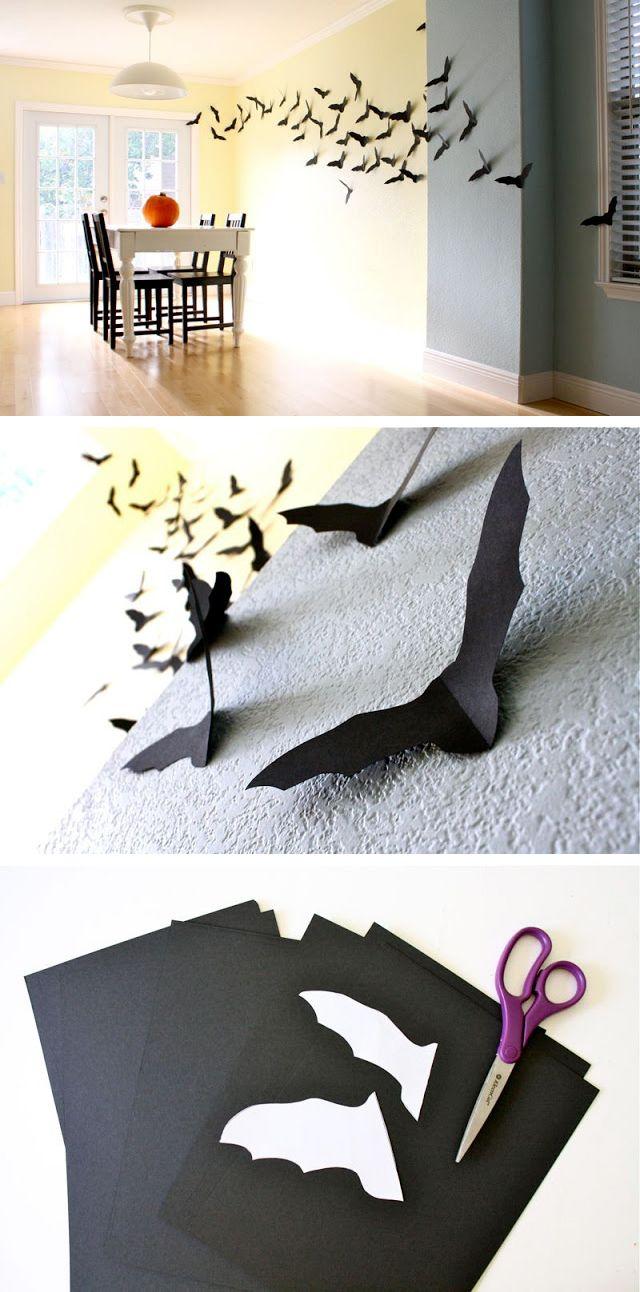 Morcegos na parede feitos de papel negro.