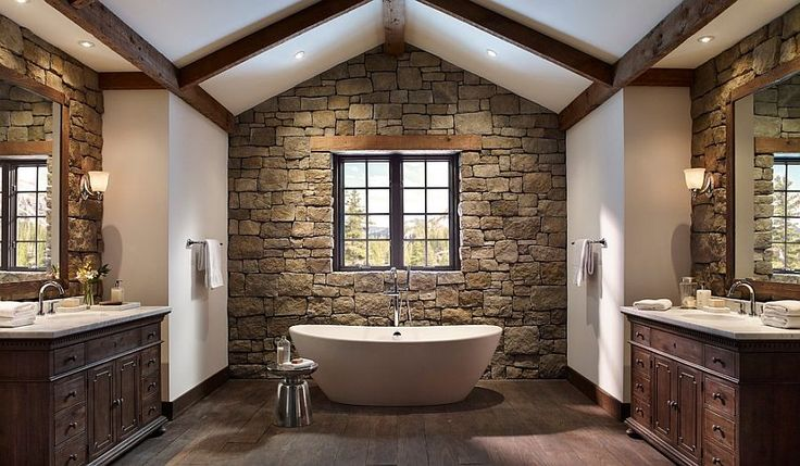 Rustic Bathroom with Natural Stone Wall containing: Unfinished Wood Flooring with Freestanding Bathtub also Classic Style Vanity Storage plus Metal Soap Stool