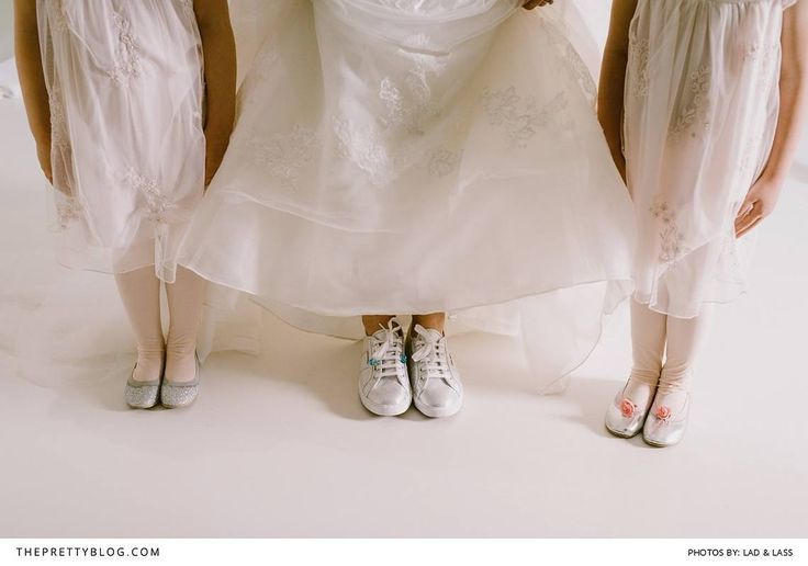 Bride with sneakers on and flower girls with silver ballet pumps | Photograph by Lad & Lass |